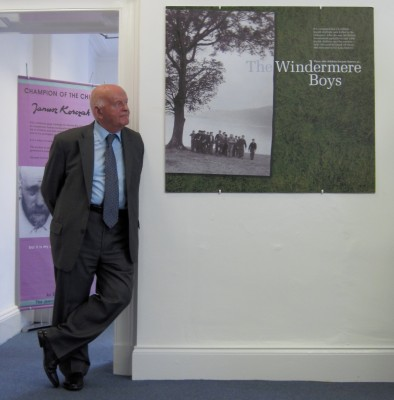 Ben Helfgott looking at images from the LDHP at Windermere