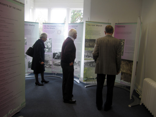 Visitors reading the banners at the exhibition