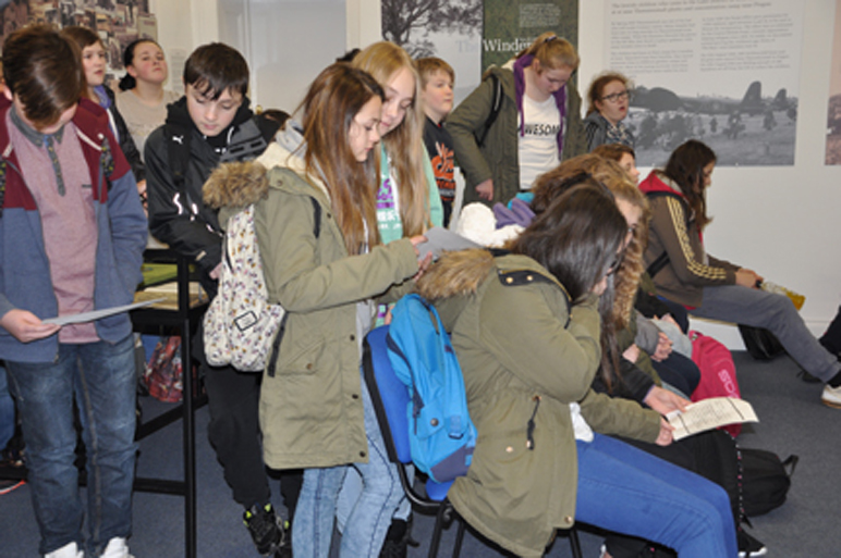 Students examining a copy of the registration form