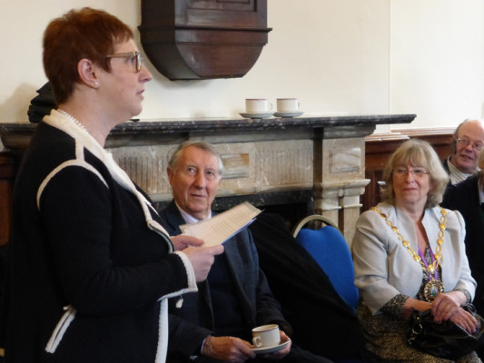 Sue talking at the Town Hall. Councillor Westwood and Professor Stanley Henig are on the right.