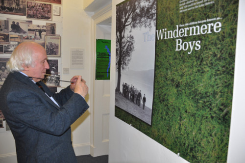 Richard looking at a photograph of the Child Holocaust Survivors