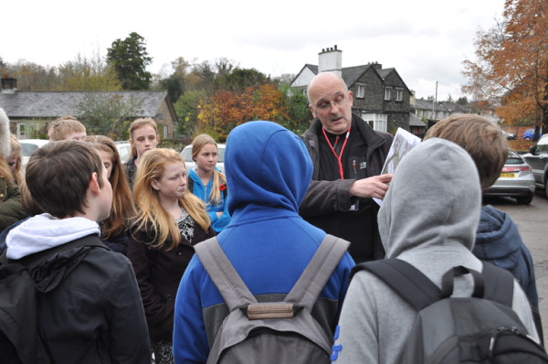 Outside the Lakes School built on the former site of Calgarth Estate. Trevor describing the results of the geo-physics scan by John Gater from Time Team.