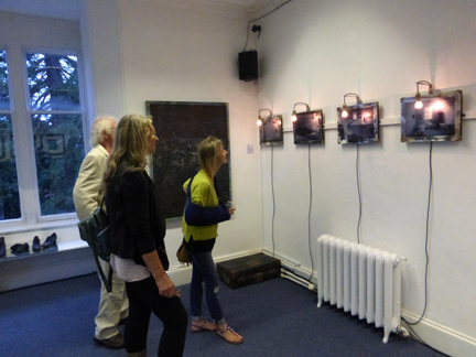 Guests looking at a series of mirrors that formed part of an installation by Ian Walton