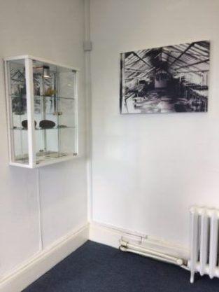 display cabinet & photograph of one of the greenhouses at Raisko